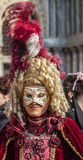 Venetian Disguise. Venice, Italy- February 18th, 2012: Environmental portrait of a woman with an eye mask (Colombina) and a sophisticated disguise in Venice stock photo
