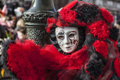 Venetian Disguise. Venice, Italy-February 18, 2012:Environmental portrait of a person wearing a complex disguise during The Venice Carnival days stock photos
