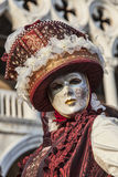 Venetian Disguise. Venice, Italy- February 18th, 2012: Portrait of a person wearing a beautiful mask and disguise during the Venice Carnival stock photos
