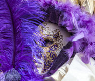 Venetian Disguise-Close-up. Venice, Italy- February 18th, 2012:Close-up image of a person with a beautiful Venetian mask during the Venice Carnival Royalty Free Stock Photo