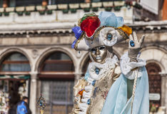 Venetian Disguise. Venice, Italy- February 18th, 2012: Environmental portrait of a person wearing a beauty Venetian costume during a the Venice Carnival days Royalty Free Stock Images