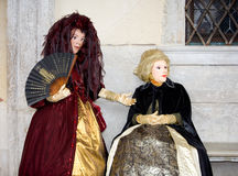 Venetian dolls. Two people posing in Venetian clothing in St Marc's Square Stock Images