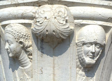 Venetian faces. Faces on column of Doges Palace,Venice ,Italy Royalty Free Stock Images