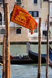 Venetian flag and gondolas Royalty Free Stock Image