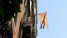 Venetian flag waving in wind on flagpole at an Venice city. Banner flutters stock video