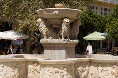 Venetian fountain in the square of Heraklion. HERAKLION, CRETE, GREECE - AUGUST 1, 2013: Venetian fountain in the square of Heraklion Royalty Free Stock Photos