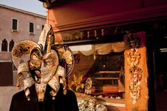 Venetian gold black and white mask and shop Stock Images