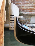 Venetian Gondola. Prow of traditional Venetian gondola rowing boat on canal, Venice, Veneto, Italy Royalty Free Stock Images