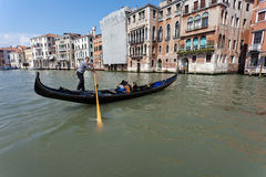 Venetian gondola. The gondola is a traditional, flat-bottomed Venetian rowing boat, well suited to the conditions of the Venetian Lagoon. For centuries gondolas Stock Images