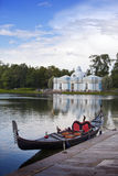 Venetian gondola on the bank of Big pond and pavilion Grotto. Pushkin, St. Petersburg Royalty Free Stock Images