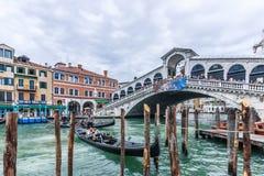 Venetian gondola. Happy tourists sitting in the gondola in Venice Italy,01.09.2014 Stock Photos