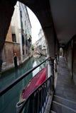 Venetian gondola moored. Next to a Palace Stock Photos