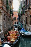 Venetian gondola staying at the canal. Stock Images