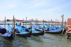 Venetian gondola. The gondola is a traditional, flat-bottomed Venetian rowing boat, well suited to the conditions of the Venetian lagoon. The gondola is Royalty Free Stock Photos