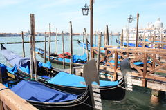Venetian gondola. The gondola is a traditional, flat-bottomed Venetian rowing boat, well suited to the conditions of the Venetian lagoon. The gondola is Stock Photography