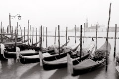 Venetian gondolas. Swinging gondolas with view of San Giorgio Maggiore Royalty Free Stock Images