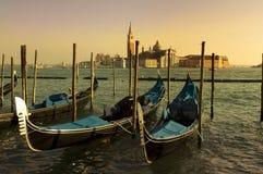 Venetian gondolas. Empty Venetian gondolas moored.Evening in Venice Royalty Free Stock Images