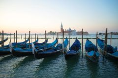 Venetian gondolas in the background of the Cathedral of San Giorgio Maggiore in the early morning. Venice, Italy Stock Images
