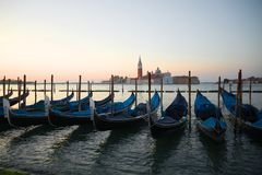 Venetian gondolas in the background of the San Marco bay at sunrise Venice, Italy. Venetian gondolas in the background of the San Marco bay at sunrise Venice Stock Photography