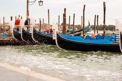 Venetian gondolas. On the dock Stock Images