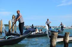 Venetian gondolas and gondoliers Stock Photo
