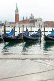 Venetian gondolas with high tide. Royalty Free Stock Photo
