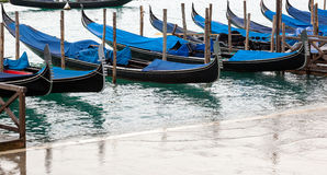 Venetian gondolas with high tide. Royalty Free Stock Photography