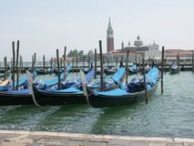 Venetian Gondolas on Lagoon. Gondolas on lagoon in Venice Italy Royalty Free Stock Photos