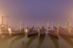 Venetian gondolas and lamps in a long time exposure in the night Stock Image