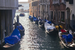 Venetian gondolas in narrow channel Royalty Free Stock Photos