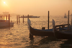 Venetian gondolas at sunrise in Venice Stock Photo