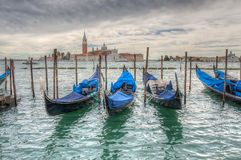 Venetian gondolas on the water HDR. Venetian gondolas on water in cloudy weather HDR Royalty Free Stock Image