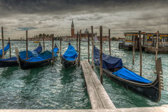 Venetian gondolas on the water HDR. Venetian gondolas on water in cloudy weather HDR Royalty Free Stock Photography