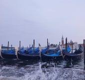 Venetian gondoler på skymning Arkivfoto