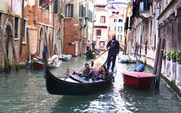 Venetian Gondolier with Couple Stock Images
