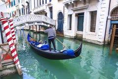 Venetian gondolier gondola through of Venice. Italy stock image