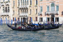 Venetian gondoliers in gondolas with tourists on Grand Canal, Venice, Italy Stock Photography