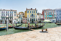 Venetian gondoliers. Venice,Italy-August 12,2014:Venetian gondoliers await some tourists to carry around on a gondola in Venice During a sunny day Royalty Free Stock Image