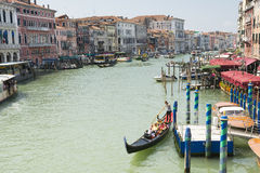 Venetian gondoliers. Venice,Italy-August 12,2014:Venetian gondoliers await some tourists to carry around on a gondola in Venice During a sunny day Royalty Free Stock Photos