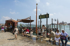 Venetian gondoliers. Venice,Italy-August 12,2014:Venetian gondoliers await some tourists to carry around on a gondola in Venice During a sunny day Stock Images