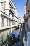 Venetian gondoliers. Venice,Italy-August 12,2014:Venetian gondoliers carry around some tourists  on a gondola in Venice During a sunny day inside her famous Royalty Free Stock Photos