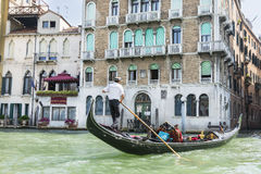 Venetian gondoliers. Venice,Italy-August 12,2014:Venetian gondoliers to carry around some tourist on a gondola in Venice During a sunny day Royalty Free Stock Photography
