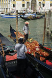 Venetian gondoliers work on gondolas Royalty Free Stock Images