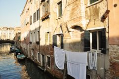 Venetian habits. Venetian habit of drying sheets outside the windows, typical, Venice, Italy, Europe Stock Photography