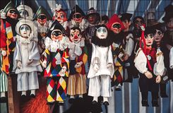 Venetian handcraft puppets in market. Traditional puppets for sale in souvenir shop royalty free stock images