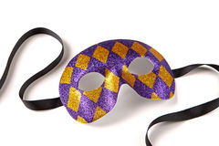 Venetian Harlequin Mask. Purple and Gold Harlequin Venetian Mask with Black Ribbon on White with Soft Shadow Stock Photography