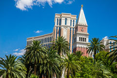 The Venetian Hotel and Casino behind palm trees Stock Photos