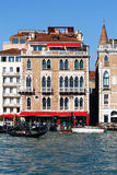 Venetian hotel facade with windows, pontoon and water. Very nice hotel facade with pontoon for gondolas in Venice, Italy. The Venetian window details and brick Royalty Free Stock Images