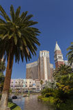 The Venetian Hotel viewed through palm trees in Las Vegas, NV on Royalty Free Stock Image
