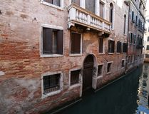 Venetian house near the navigable canal in Venice in Italy. Without boats Royalty Free Stock Images